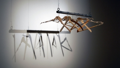 01Migration (2008) Carved woden coat hangers 40 x 12 x 8 inches