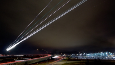 Three night landings on runway 10L at SFO (behind camera) on February 21, 2009