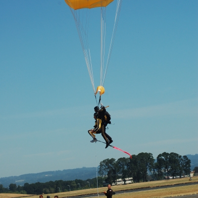 23 Hillsboro Mayor Jerry Wiley lands with Staff Sergeant Noah Watts of the Golden Knights