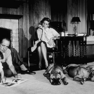 1952 - Bacall and Bogart at home in Los Angeles with their son, Stephen, and three pet boxers, Harvey, George and Baby (Sid Avery)