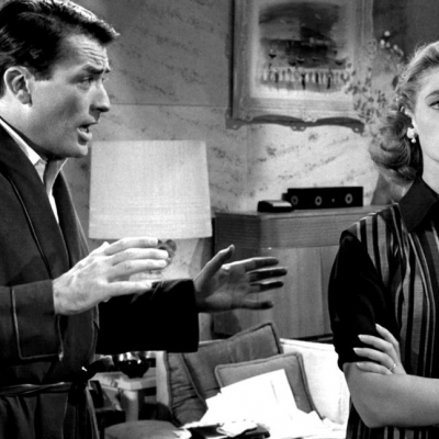 1957 - Bacall with Gregory Peck in a scene from 'Designing Woman' (MGM)
